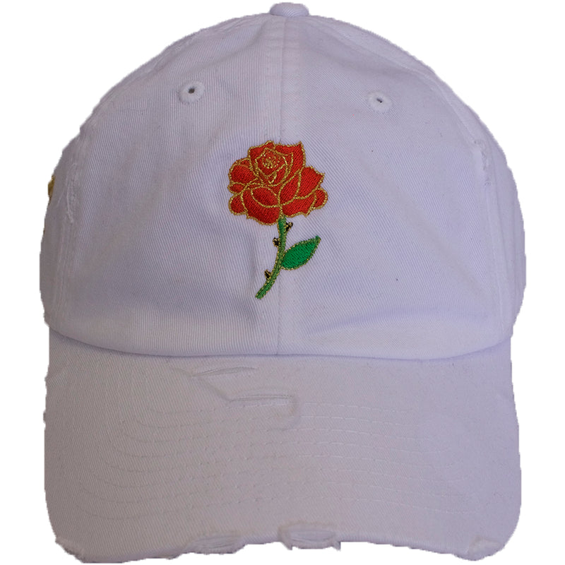 the white rose bud distressed dad hat is solid whit with a red, green, and gold rose embroidered on the front