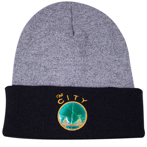 d53653d9bb7 the mitchell and ness golden state warriors hologram winter beanie has a  gray crown and black