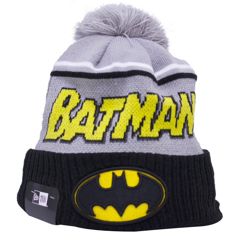 on the front of the batman comic con winter beanie, there is batman lettering in yellow and black. On the front of the black raised cuff, the batman logo is embroidered in black and yellow