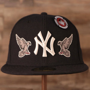 On the front of the Everything New York All Over Patch Embroidery Yankees Fitted Cap there are embroidered pigeons facing opposite direction, flocking towards the Yankees logo