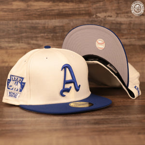 The old school Philadelphia Athletics 1929 World Series Side Patch Gray Bottom 59Fifty Fitted Cap features a cream crown and flat royal blue brim.