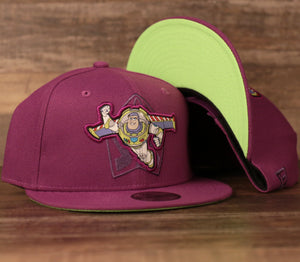 The buzz lightyear purple kids snapback hat features a purple crown, purple brim, and bright green under brim