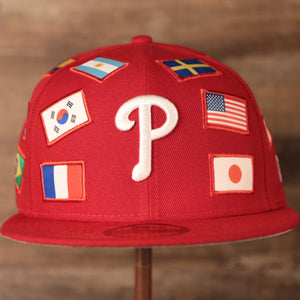 Phillies World Flags Gray Bottom Fitted Cap | Philadelphia Phillies International Flags Red Grey Under Brim Fitted Cap the front of this philies cap has flags from the countries of America, Japan, and France