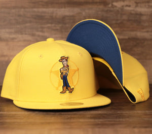 The toy story woody kids snapback hat is golden yellow with a blue under brim