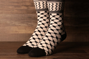 The black and white Arafat arabian knit socks feature the iconic checkered muslim head scarf pattern in black and white