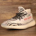 The Yeezy 350 V2 Zebra sneakers featuring the black rope yeezy matching sneaker shoe laces
