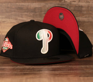 The phillies italian pride 59fifty fitted cap has a black crown, black brim, with italian colorway embroidery and a red under brim