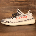 Side view of the Yeezy Boost 350 V2 Zebra sneakers featuring the black Yeezy Boost 350 V2  Black yeezy matching sneakers