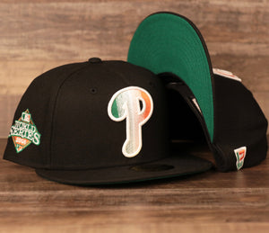 The Phillies Irish Pride 59Fifty fitted cap has a black structured crown, a black flat brim, and irish colorway embroidery with a irish green under brim