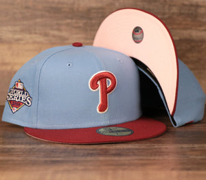 The Philadelphia Phillies Current Logo 2008 World Series Retro Cooperstown Colorway 59Fifty Fitted Cap features a cooperstown blue structured crown, a maroon flat brim, the 2008 World Series Patch in a cooperstown blue/maroon colorway with a pink under brim