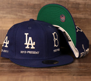 A Los Angeles Dodgers blue all-over fitted hat with green bottom brim by New Era.