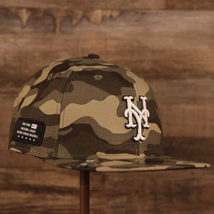 The National League New York Mets woodland camo 2021 Armed Forces Day 950 snapback hat.