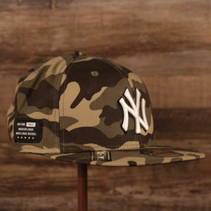 The New York Yankees woodland camo 9fifty snapback hat for the 2021 Memorial Day by New Era.
