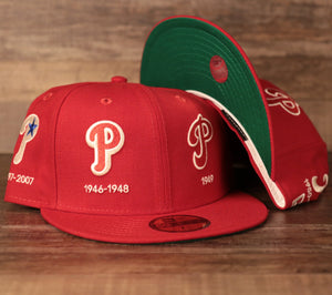 A Phillies red 59fifty with all-over embroidery of the team's logo history designed by New Era.