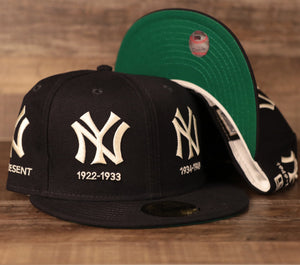 A Yankees all-over patch fitted hat with the Yankees logo history by New Era.