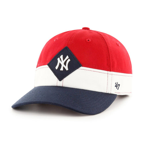 on the front of the new york yankees three color dad hat is a navy blue diamond shape and the new york yankees logo embroidered in white