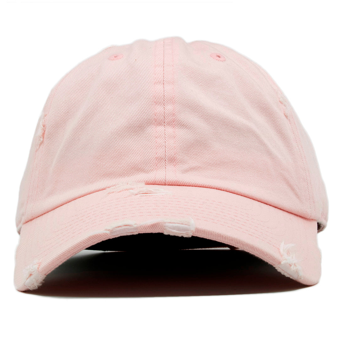 8775897abcaccd The blank pink vintage distressed dad hat has a soft crown and a bent brim.