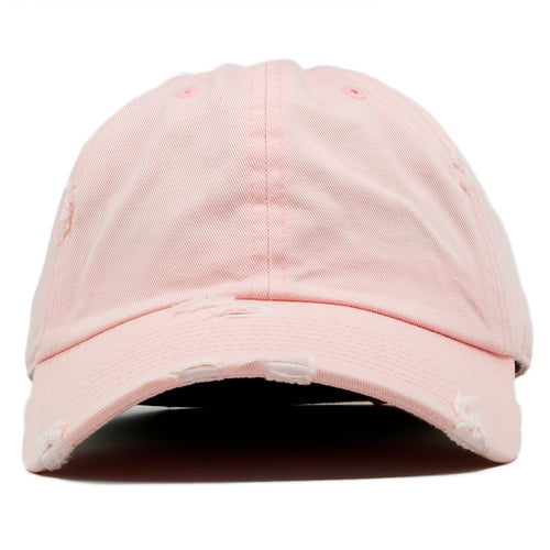 The blank pink vintage distressed dad hat has a soft crown and a bent brim.