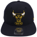 on the front of the chicago bulls retro air jordan 4 dunk from above sneaker matching snapback hat has a windy city chicago bulls logo embroidered in navy blue, white, and yellow