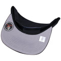 the under brim of the chicago bulls dunk from above jordan 4 sneaker matching snapback hat is gray