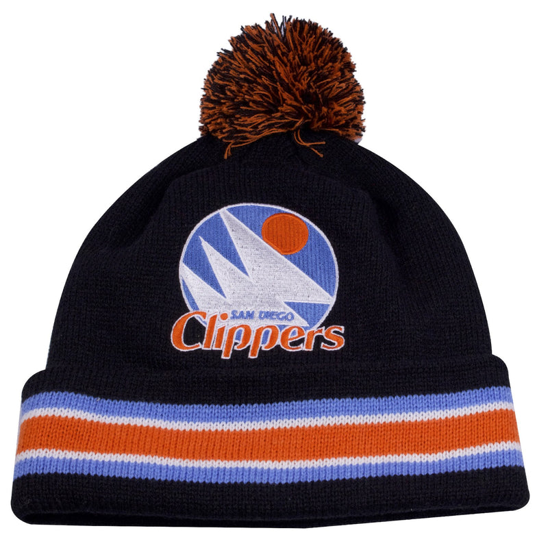 the vintage san diego clippers winter beanie has a black crown, black raised cuff with orange, white, and light blue horizontal stripes, orange and black pom, and throwback san diego clippers logo embroidered on the front of the crown