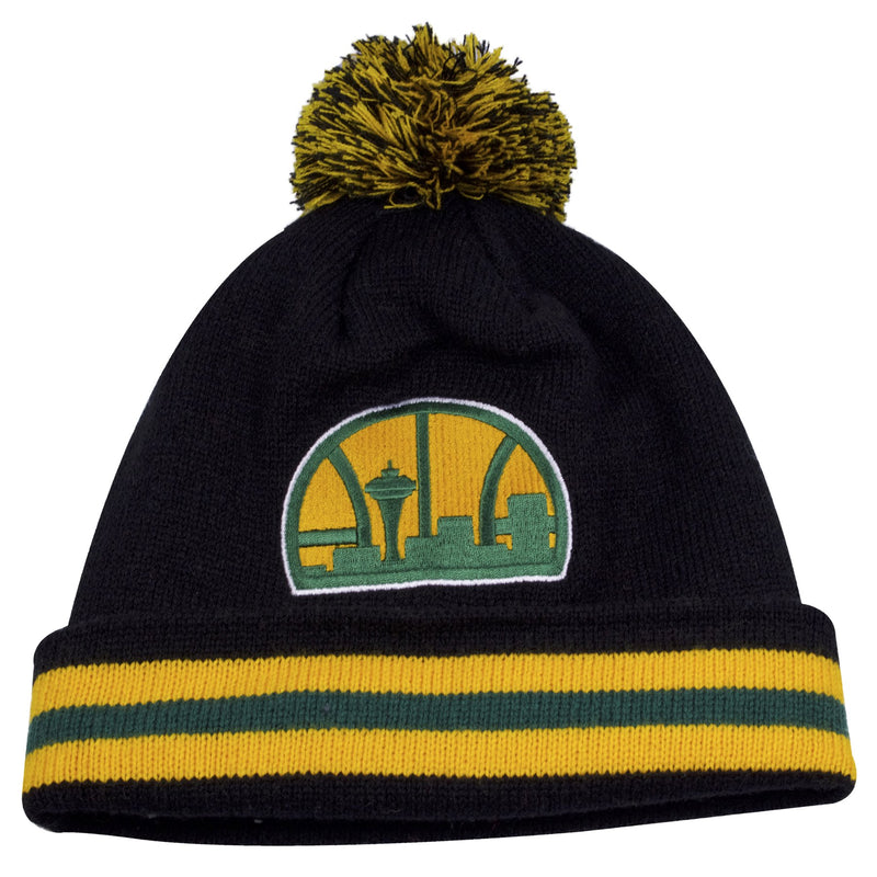 the seattle super sonics vintage winter beanie is black with yellow and green stripes on the raised cuff, a vintage seattle supersonics logo embroidered on the crown, and a yellow and green pom