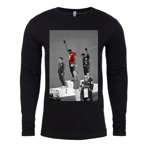 the colin kaepernick 1968 olympic black power long sleeve t-shirt is solid black with long sleeves 100% cotton and the 1968 black power protester wearing a colin kaepernick jersey
