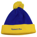 on the back denver nuggets vintage blue winter beanie is the mitchell and ness logo embroidered in blue on the yellow raised cuff