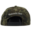 on the back of the charlotte bobcats woodland camouflage neoprene snapback hat is the mitchell and ness logo embroidered in silver