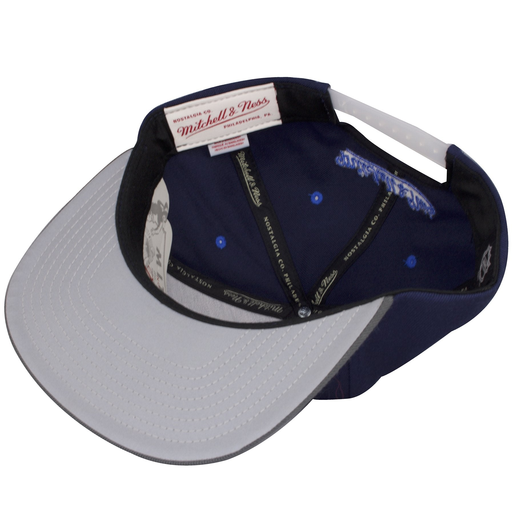 ... hat has the mitchell and ness logo embroidered  the under brim of the winnipeg  jets reflective snapback is a reflective gray 377198a2ebb2