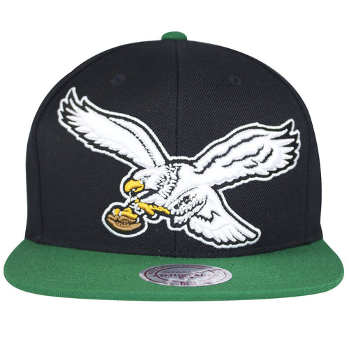 on the front of the Philadelphia Eagles vintage Mitchell and Ness snapback hat, the throwback Philadelphia Eagles logo is embroidered in white, black, yellow, and brown
