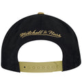 on the back of the new orleans saints throwback special script snapback hat is a mitchell and ness logo embroidered in tan above a tan adjustable snap
