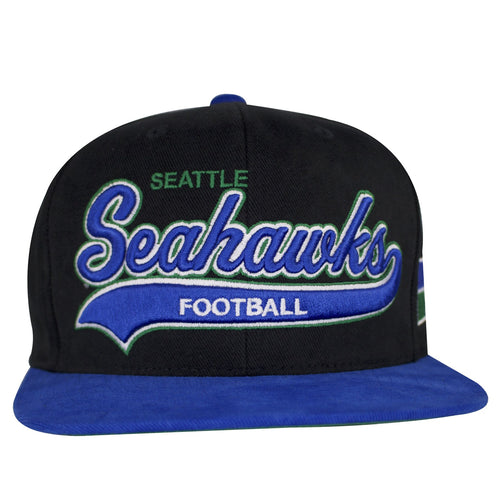 A cursive writing logo in embroidery of the Seahawks can be shown on the front across this Seattle Seahawks Retro Snapback cap, outlined in white and green. A script text of Seattle is above Seahawks. The S in Seahawks is extended to across below Seahawks. The word Football is embroidered below Seahawks. Blue flat bill.