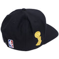 on the back of the cleveland cavaliers 2016 nba champions snapback hat is a white, red and blue nba logo embroidered. On the right side is the nba finals trophy embroidered in gold