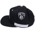 on the sides of the brooklyn nets on court shorts inspired snapback hats, the nets shorts logo is embroidered  in black and white above a white embroidered accent