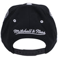 on the back of the brooklyn nets on court basketball shorts inspired snapback hat has the mitchell and ness logo embroidered in white