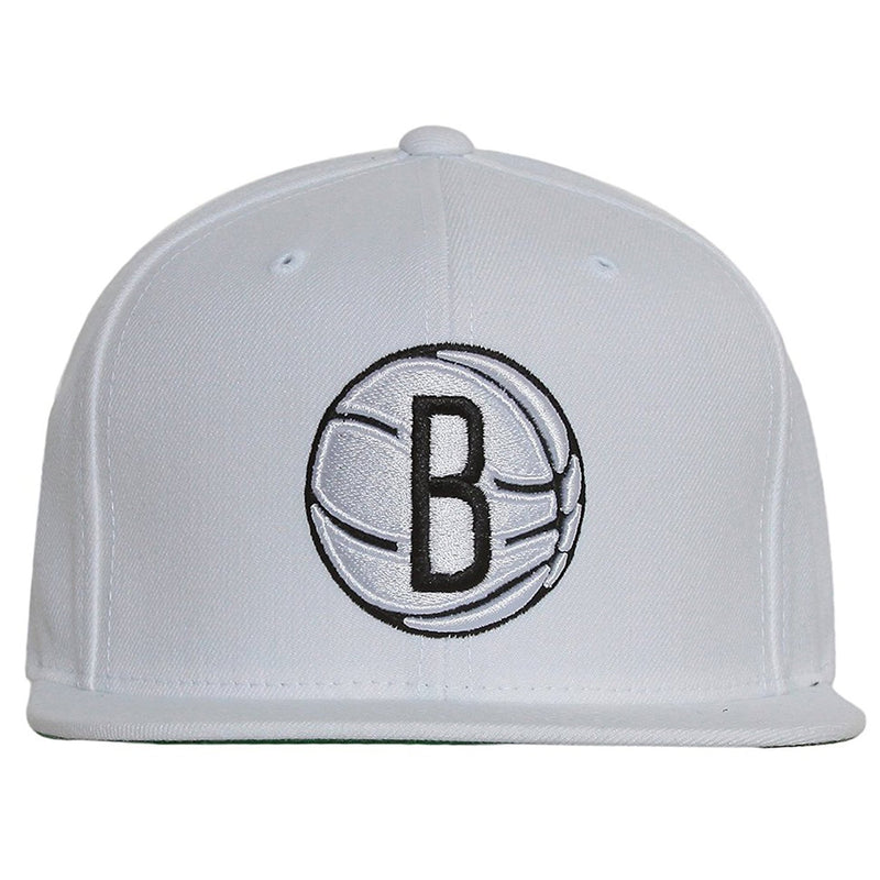 on the front of the brooklyn nets white classic snapback hat is a white structured crown with a white flat brim. The brooklyn nets logo is embroidered in white and black