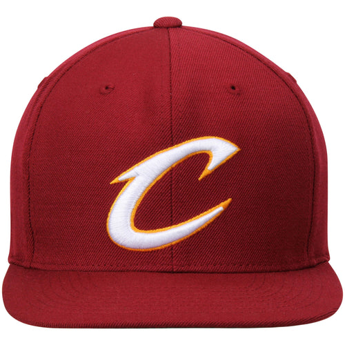 on the front of the classic Cleveland Cavaliers snapback hat is the Cleveland Cavaliers C logo embroidered in white and gold