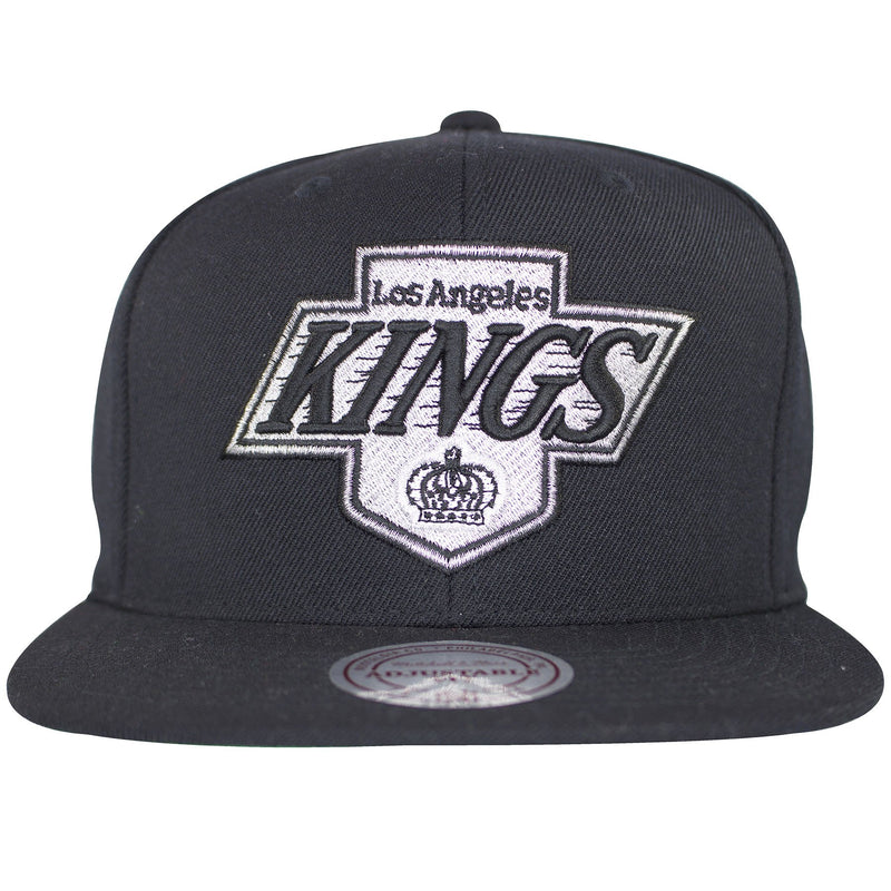 on the front of the los angeles kings vintage classic black snapback hat is the los angeles kings vintage logo embroidered in gray and black