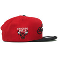 on the right side of the nba finals 1991 chicagobulls snapback hat is the chicago bulls vintage logo embroidered in white, red, and black