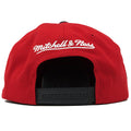 on the back of the mitchell and ness nba finals 1991 snapback hat is the mitchell and ness logo embroidered in white