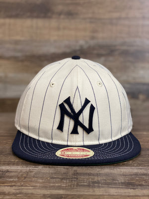 on the  front of Yankee Retro Crown Heritage series coopertown pinstripe 9fity strap back hat | Cream Navy
