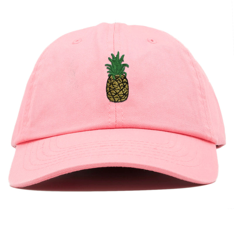 on the front of the pink pineapple dad hat, there is a pineapple embroidered in gold, black, and green