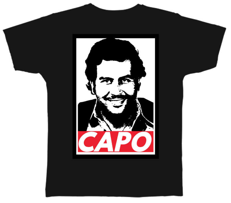the pablo escobar narcos mugshot t-shirt has pablo escobar's mugshot on the front in black and white with capo written on the bottom in white on red