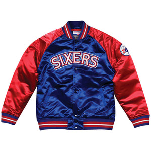 On the front of the Philadelphia 76ers retro throwback satin varsity jacket is the retro Sixers wordmark embroidered in white, red, and blue