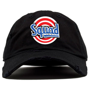 the space jam squad distressed dad hat has is solid black and distressed with a red, white, and blue squad logo embroidered on the front