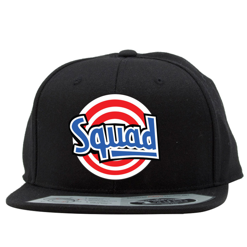 the tune squad space jam jordan 11 matching snapback hat has a red, white and blue logo embroidered on the front of a solid black snapback hat