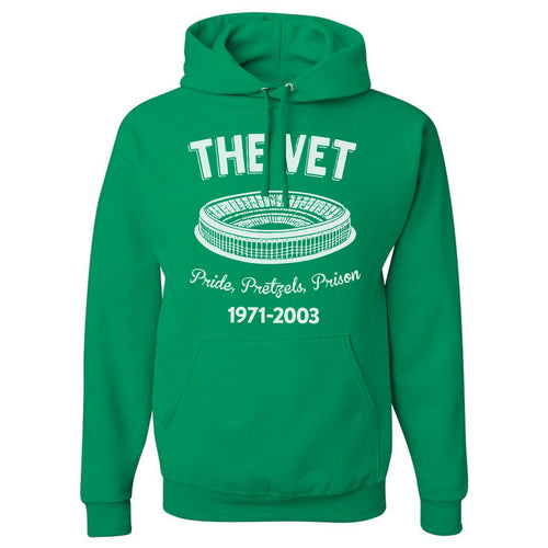 "printed on the front of the kelly green veteran's stadium hoodie are the word's ""the vet"", an image of the veterans stadium, the words pride pretzels prison, and the years that the veterans stadium in philadelphia was in operation"