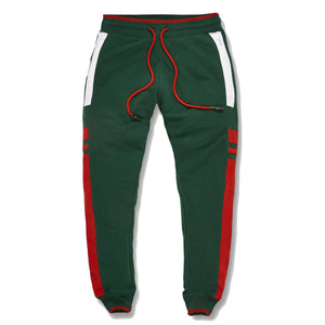 the green and red gucci colorway track pants are solid green with red and white accents along the pantleg of the gucci colorway green and red inspired track pants