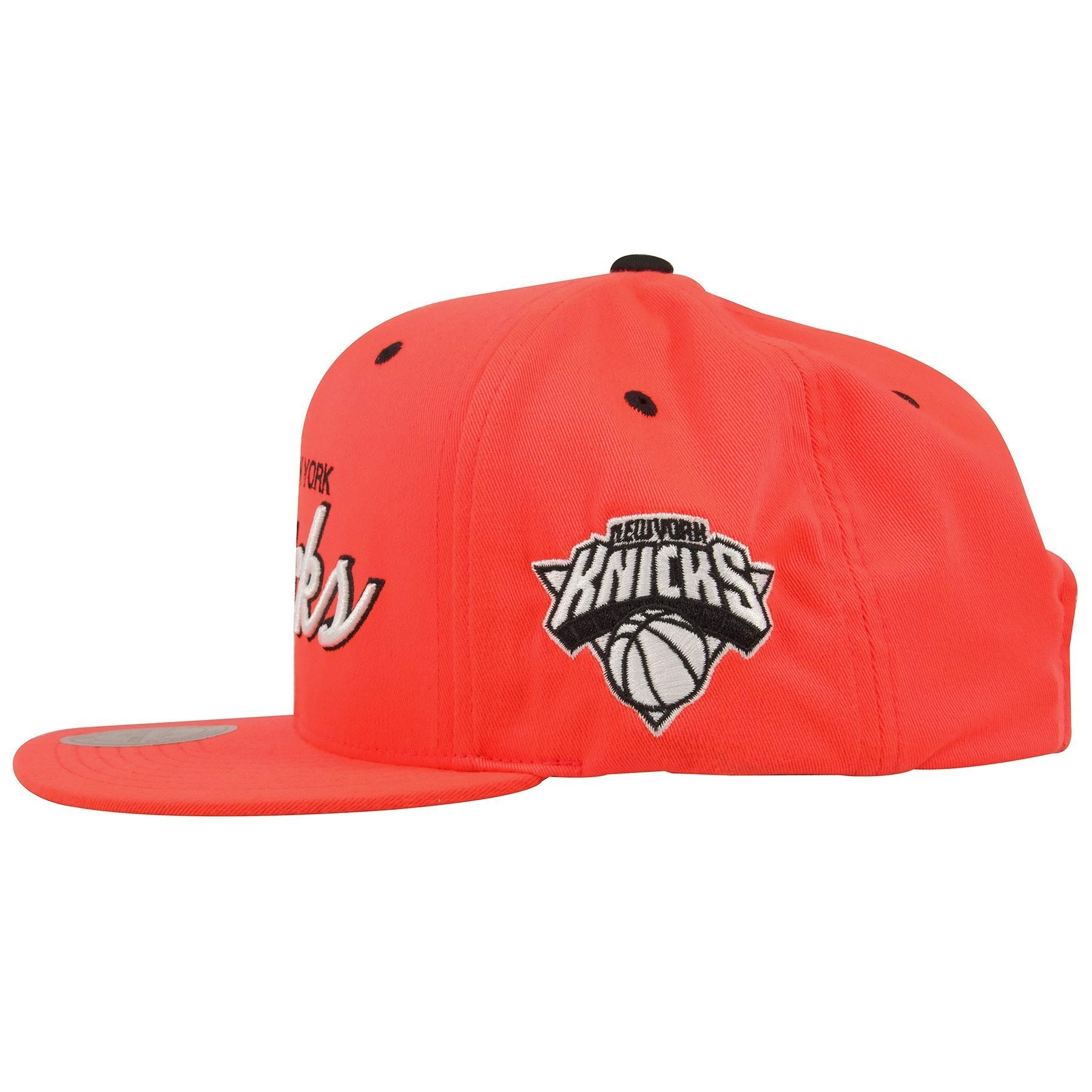 97546af0c9f The left side of this Mitchell and Ness New York Snapback hat shows the New  York ...